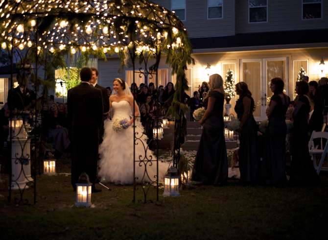 Bride And Groom During Evening Ceremony Lit By Candles