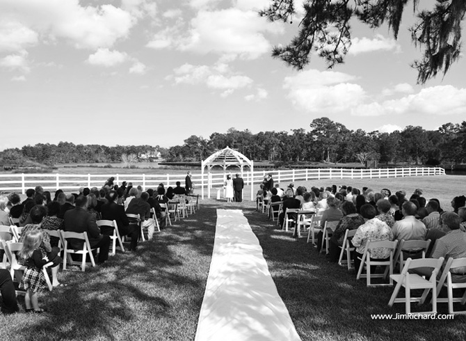 Guests Facing Gazebo And Bayou During Ceremony