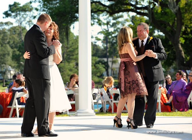 Two Couples Dancing In Front Of White Columns On Dance Floor